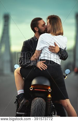 Young Sexy Woman Hugging Cute Man In Stylish Black Leather Jacket, Sitting On Sports Motorcycle On T