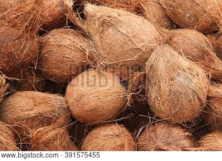 A Selection Of Coconut Husks As A Background Display.