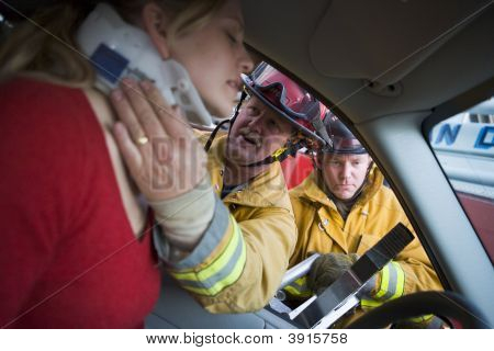 Firefighters Saving Woman In Car