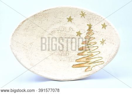 Toys For Christmas Tree, Festive Plate, Stand Decorated With Golden Christmas Tree And Stars, On A W