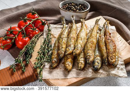 Fried Smelt, Sprats. Small Fried Fish. Gray Background. Top View