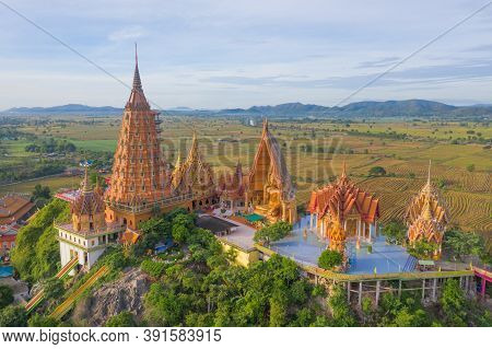Aerial View Of Big Golden Buddha Statue And Pagoda In Tiger Cave Temple Or Wat Tham Suea In Kanchana