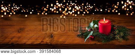 Background For Christmas With Burning Red Candle And Natural Decoration On Rustic Wooden Board. Back