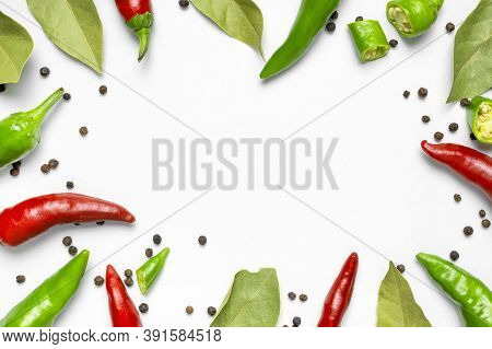 Hot Red And Green Fresh Chili Peppers Bay Leaf Dry Black Peppercorns On White Background Flat Lay To