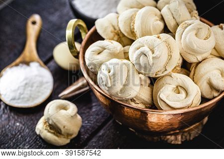 Copper Pot With Homemade Cookies, Sighs, Also Called Merengue, Brazilian And French Cuisine