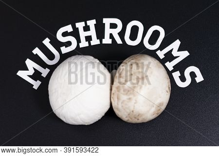 Two Champignons Are Arranged Horizontally. Above Is Written Mushrooms.