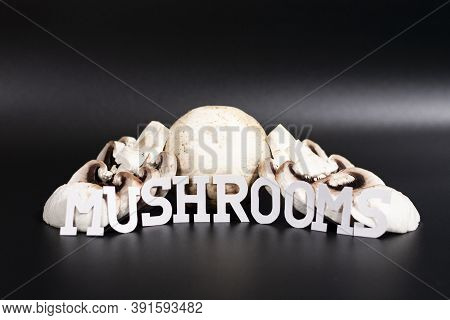 Group Champignons Arranged In The Form Of A Slide. Some Of Them Are Cut Into Slices. The Inscription