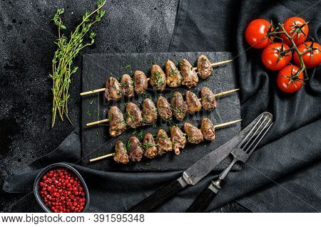 Skewered And Grilled Chicken Hearts. Yakitori. Black Background. Top View