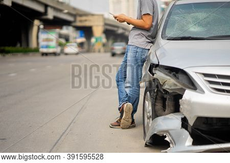 Male Motorist Involved In Car Accident Calling Insurance Company Or Recovery Service, Man Roadside S