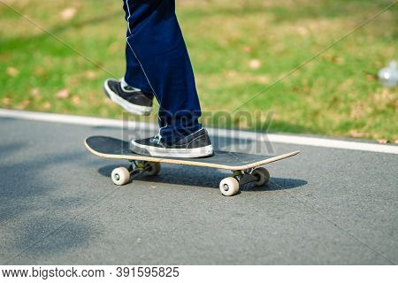 Cropped View Of Skateboarder Skateboarding At Skatepark.