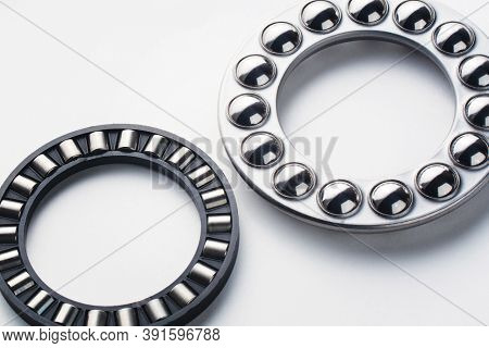 Metal Thrust Ball And Roller Bearing Isolated On White Background. Spare Part For Heavy And Automoti