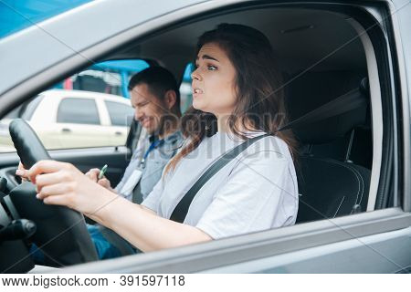 Nervous Upset Woman Cant Take Driving Exam. Car Accident During Driving Lesson Concept. Usatisfied M