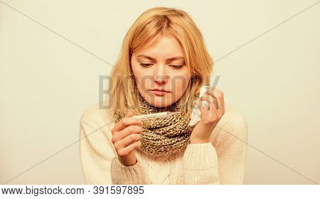 Cold And Flu Remedies. Take Temperature And Assess Symptoms. High Temperature Concept. Woman Feels B