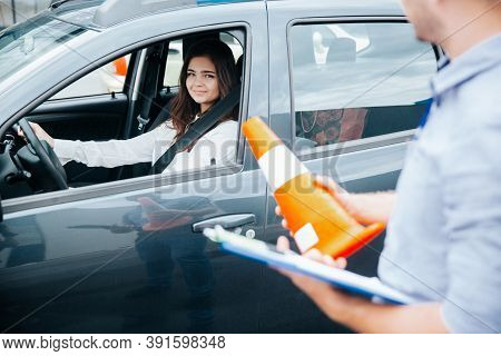 Positive Experience In Driving School. Cheerful Confident Young Woman Is Glad For Improvement Of Her