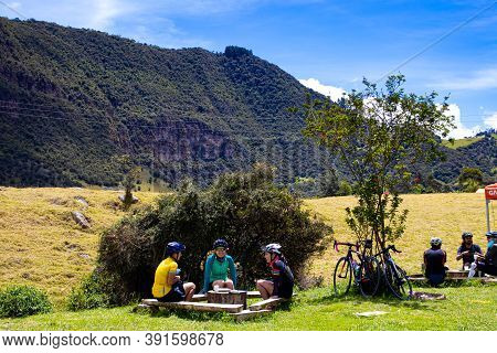 La Calera Colombia - October, 2020:  Cyclist Chatting At The Famous Alto De Las Arepas A Well Known
