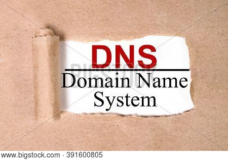 Dns.domain Name System, Text On White Paper On Torn Paper Background