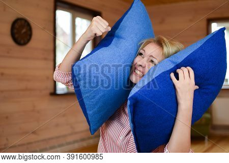 Woman Covered Ears With Pillow. Noisy Neighbors Make It Difficult To Live Peacefully. Woman Was Tire