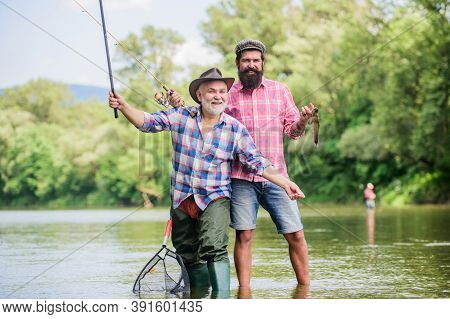 Fishing Peaceful Activity. Father And Son Fishing. Grandpa And Mature Man Friends. Fishing With Spin