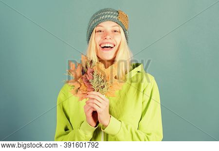 Woman Cute Face Wear Knitted Hat Hold Fallen Leaves. Autumn Skincare Tips. Skincare And Beauty Tips.