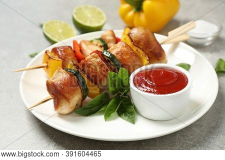 Delicious Chicken Shish Kebabs With Vegetables And Ketchup On Grey Table, Closeup