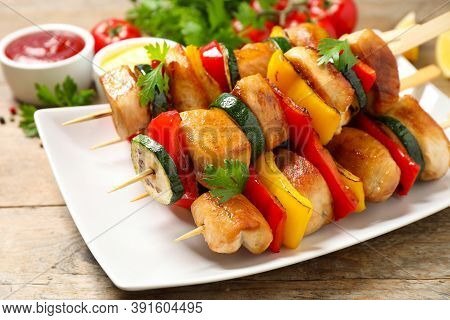 Delicious Chicken Shish Kebabs With Vegetables On Wooden Table, Closeup