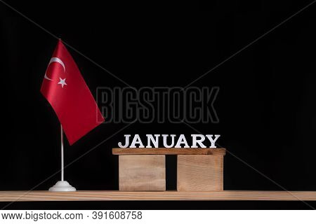 Wooden Calendar Of January With Table Turkish Flag On Black Background. Holidays Of Turkey In Januar