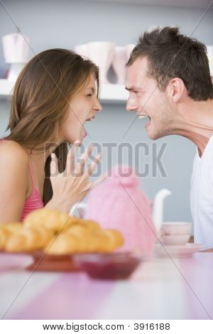 Couple Arguing At Breakfast