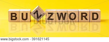 Buzzword Word Is Made Of Wooden Building Blocks Lying On The Yellow Table