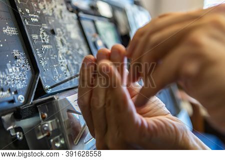 Selective Focus Of Male Technician Hands Unscrewing Bolts To Analyse Issue With Broken Computer And
