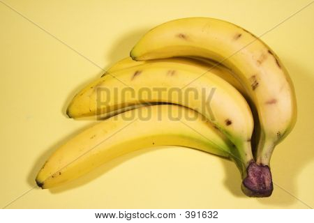 a bunch of bananas on a yellow background. poster