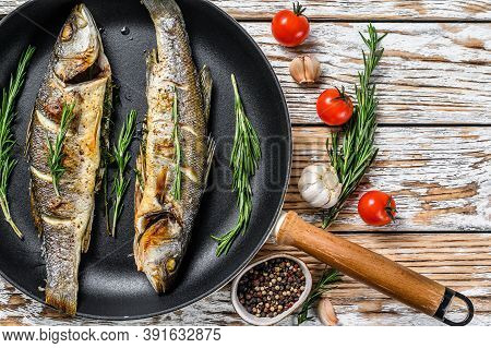 Bbq Sea Bass Fish, Fried Sea Bass In A Pan. White Wooden Background. Top View. Copy Space