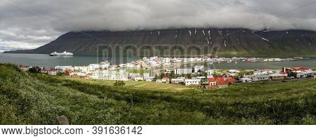 Wide-angle Panorama Of The Isafjordur City In Iceland With Storm And Fog Coming