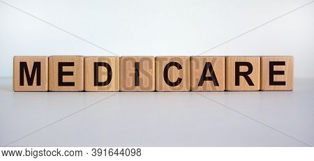 Wooden Cubes With Word 'medicare'. Beautiful White Background. Medical Concept. Copy Space.