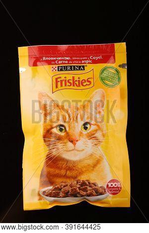 Lviv, Ukraine - September 22, 2020: Friskies Cat Food In The Package Black Background