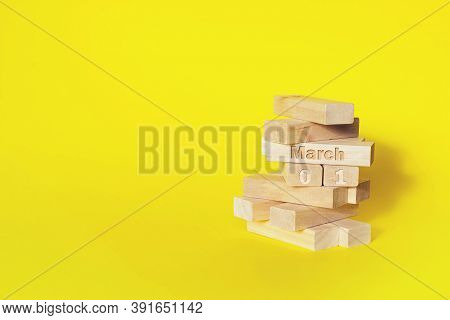 March 1st . Day 1 Of Month, Calendar Date. Wooden Blocks Folded Into The Tower With Month And Day On