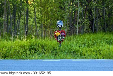 Motorcycle Riders Tombstone, Riders Grave, Helmet In The Grass