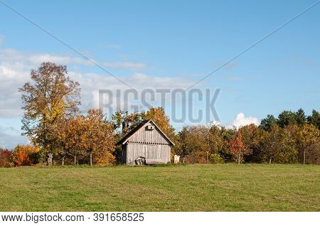 A Wooden Hut In An Orchard On A Sunny Day In Autumn