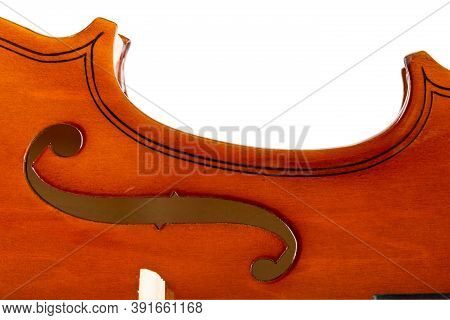 Close Up Macro Of F Hole On Brown Wooden Fiddle Or Violin, Classic Musical Instrument, Isolated On W