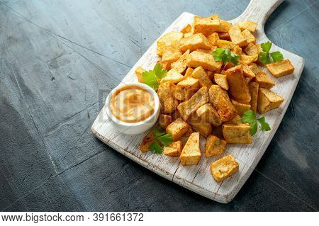 Patatas Bravas Traditional Spanish Potatoes Snack Tapas On White Wooden Board