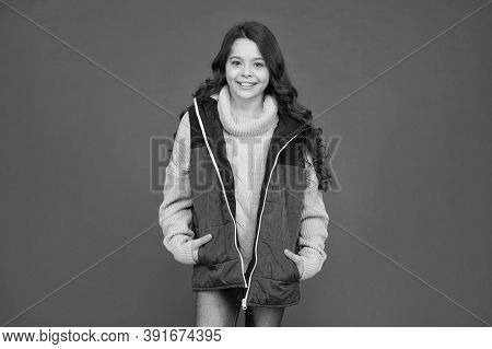 Born Stylish. Happy Child With Stylish Look. Little Girl Wear Stylish Gilet Red Background. Cute And
