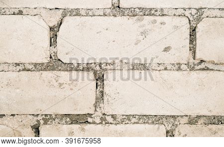Part Of An Old Brick Wall With Cement. Close-up Old Brick Wall Texture. Masonry With Cement. Macro S