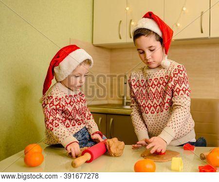 Happy Kids Making Cookie For Santa In Warm Kitchen. Santa Chefs. Beautiful Boys Bake Homemade Festiv