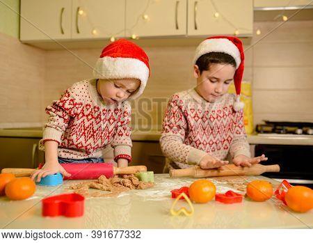 Cute Little Boys Bake Homemade Festive Gingerbreads. Homemade Baking. Funny Children Prepare Holiday