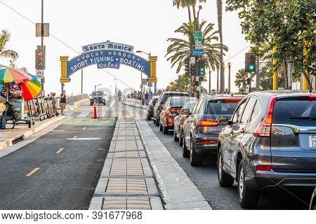 Santa Monica, California - October 09 2019: Entrance To Iconic Santa Monica Pier And Beach On Ocean