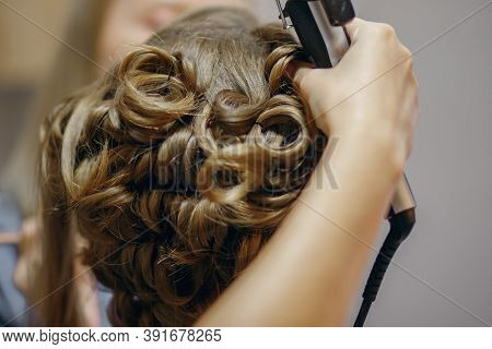 Curlers Make Curls On Women's Hair. Hairdresser Services For The Concept Of Evening And Festive Hair