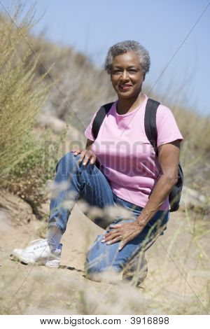Senior woman on a walking trail poster