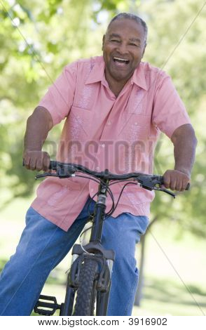Senior Man On A Bicycle