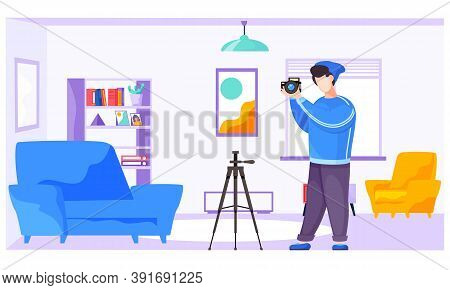 The Guy Standing And Adjusting The Lens. Photographer With A Camera And A Tripod In The Apartment. T