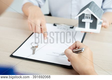A Real Estate Agent With Rental Homes And Home Insurance For Clients To Sign Contracts Under A Forma