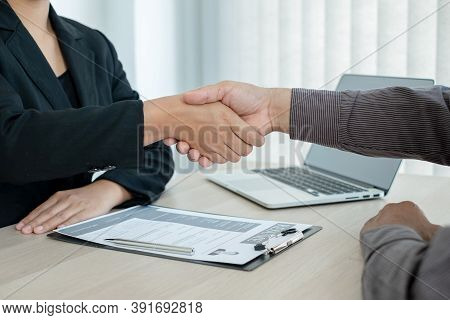 Friendly Businessmen And Executives Shake Hands After Successful Agreement With Employment Contracts